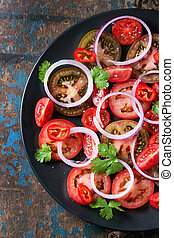 Tomates y ensalada de cebolla