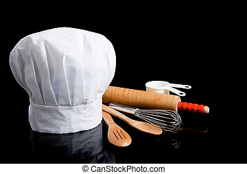 Toque con utensilios de cocina