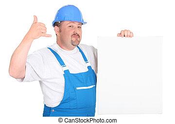 Trabajador de construcción con panel