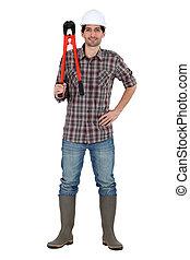 Trabajador de construcción con pernos