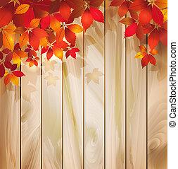 Trasfondo de otoño con hojas en una textura de madera