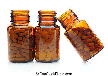 Tres botellas de pastillas marrón