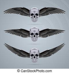 Tres cráneos de cromo de metal con dos alas
