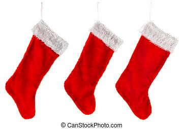 Tres medias de Navidad rojas tradicionales