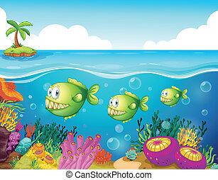 Tres pirañas verdes bajo el mar