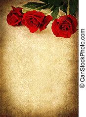 Tres rosas rojas sobre fondo grunge