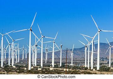 Turbinas de viento con tres hojas en el desierto