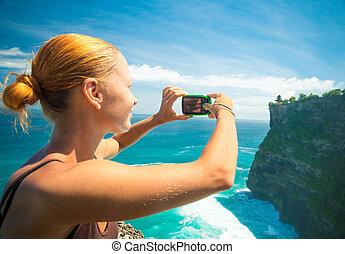 Turista tomando fotos