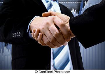 Un apretón de manos y un diagrama