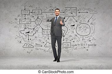 Un apuesto hombre de negocios mostrando los pulgares