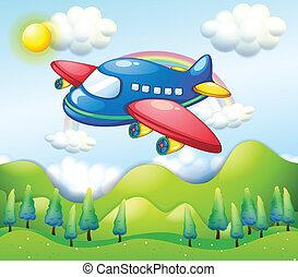 Un avión colorido sobre las colinas