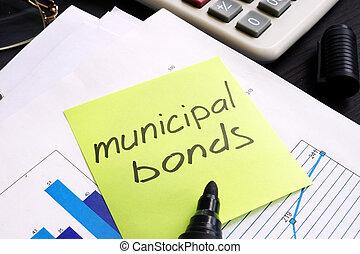 Un bono municipal escrito en una memoria y documentos.