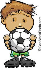 Un chico de fútbol sonriente sosteniendo fútbol