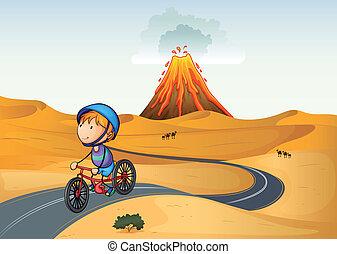 Un chico en bicicleta en el desierto