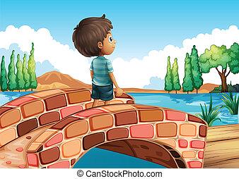 Un chico en el puente