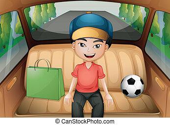 Un chico sentado dentro de un auto