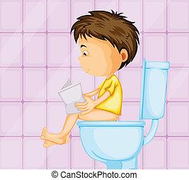 Un chico sentado en el baño