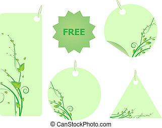 Un conjunto de etiquetas verdes con adornos arremolinados con hojas