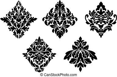 Un conjunto de patrones florales antiguos y adornos