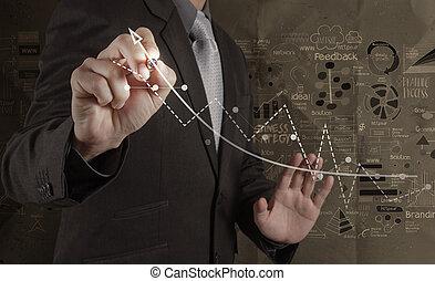 Un empresario que trabaja con una nueva computadora moderna y una estrategia de negocios a mano sobre fondo de papel arrugado como concepto