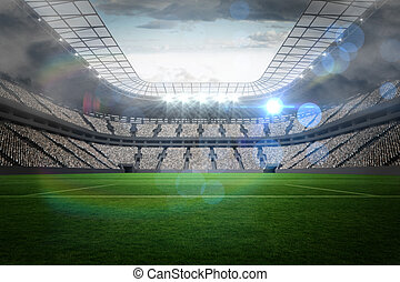 Un estadio grande de fútbol con luces