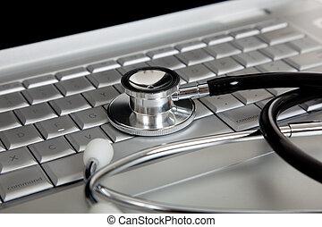 Un estetoscopio médico y una computadora portátil