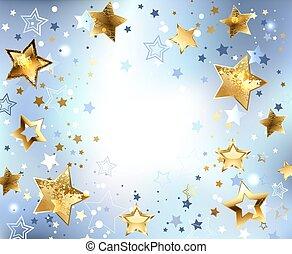 Un fondo azul con estrellas doradas