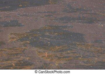 Un fondo oxidado de metal marrón gris de una pieza de hierro