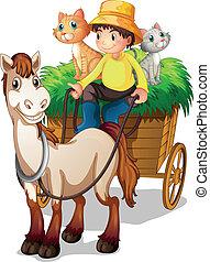 Un granjero montando en un carrito de paja con sus animales de granja