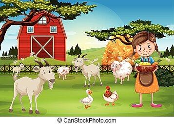 Un granjero trabajando en la granja con animales
