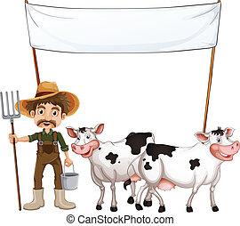 Un granjero y sus vacas cerca de la bandera vacía