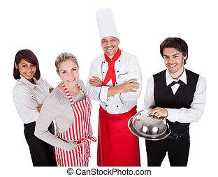 Un grupo de chefs y camareros