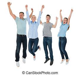 Un grupo de gente saltando