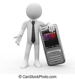 Un hombre apoyado en un gran teléfono móvil