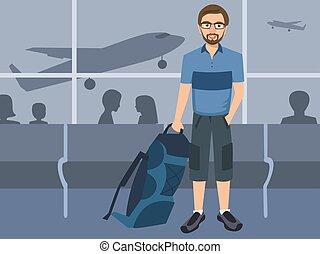 Un hombre con mochila en el aeropuerto