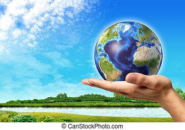 Un hombre con un globo terráqueo en él y un hermoso paisaje verde con río y cielo azul, en el fondo.