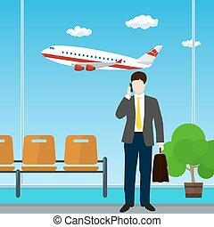 Un hombre con un maletín en el aeropuerto