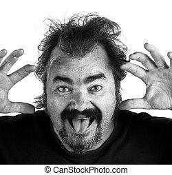 Un hombre enojado gritando de rabia extrema, BW
