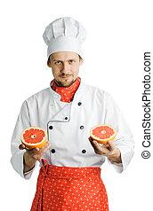 Un joven y apuesto cocinero