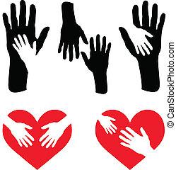 Un juego de manos y mano en el corazón rojo