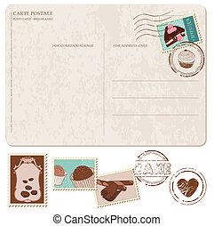 Un juego de pasteles en una vieja postal, con sellos, para diseño y álbum de recortes