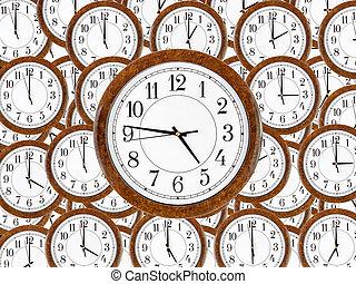 Un juego de relojes de pared con marco de madera marrón