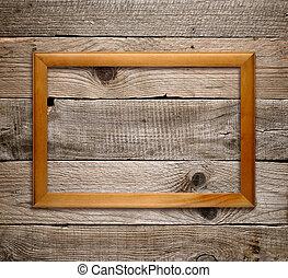 Un marco de madera en el fondo de madera