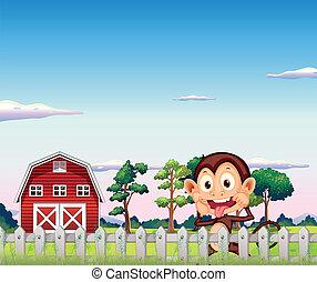 Un mono cerca del establo rojo