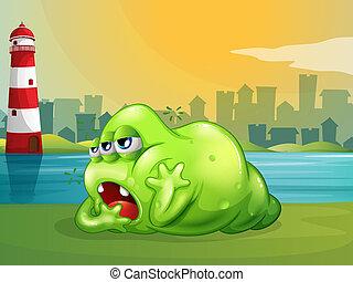 Un monstruo verde a través del faro