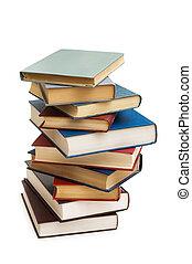 Un montón de libros aislados en el blanco