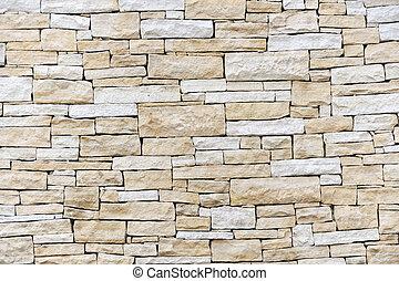 Un muro hecho de ladrillos de arenisca