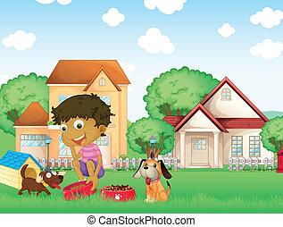 Un niño alimentando a sus cachorros