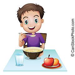 Un niño comiendo su desayuno en la mesa