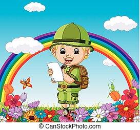 Un niño de dibujos animados escribiendo en un jardín de flores con arco iris